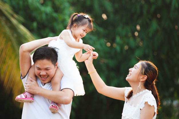 asian-family-father-mother-daughter-playing-together-park-with-love-happiness_7186-2612